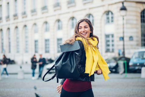Cheerful woman in the city