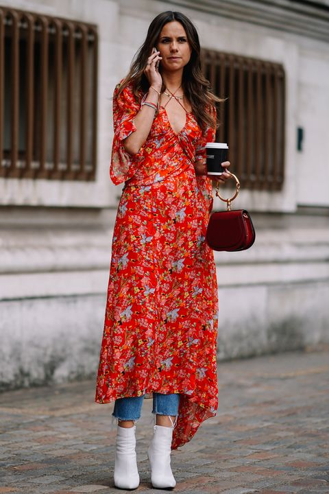 A Street Styler Wearing Dress Over Jeans