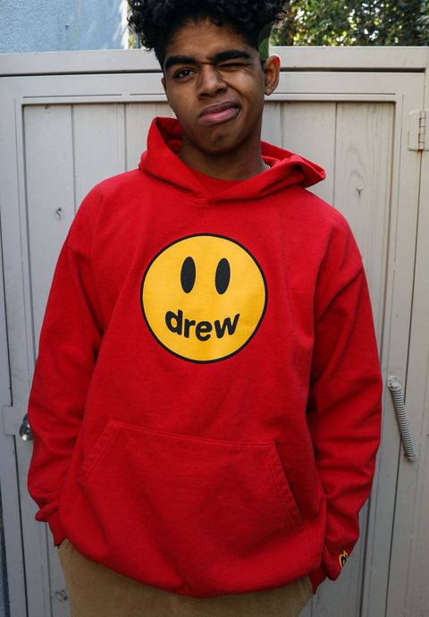 Hoodie, Black, Facial expression, Outerwear, Clothing, Smiley, Red, Smile, Yellow, Emoticon,