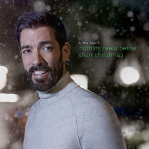 """drew scott surrounded by snow next to text with his name and """"nothing feels better than christmas"""""""