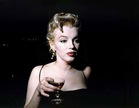 Marilyn Monroe Carrying a Drink