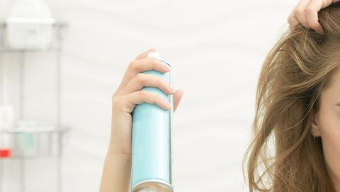 Woman using dry shampoo