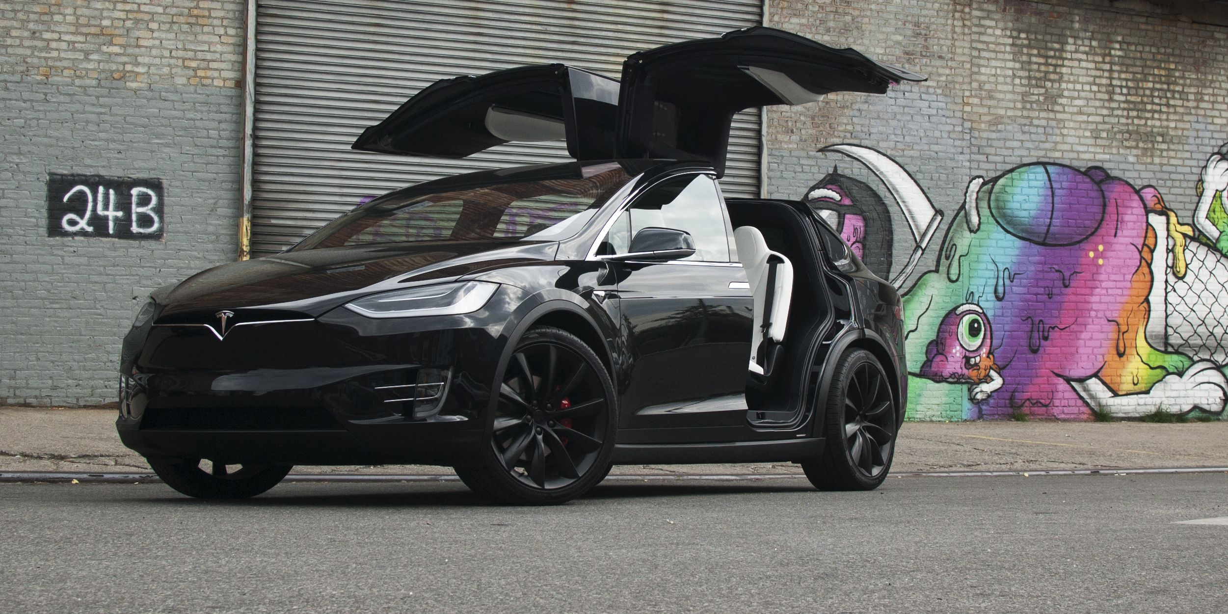 Tesla S Silly Falcon Wing Doors Have One Great Function