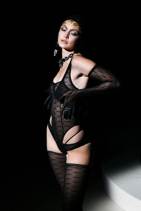 Clothing, Stocking, Thigh, Leg, Fetish model, Agent provocateur, Lingerie, Model, Latex clothing, Garter,