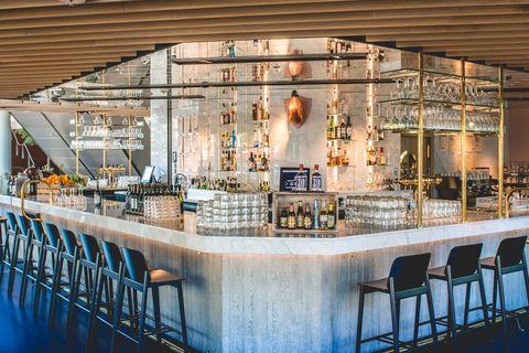 Building, Restaurant, Architecture, Bar, Interior design, Room, Furniture, Ceiling, Table,