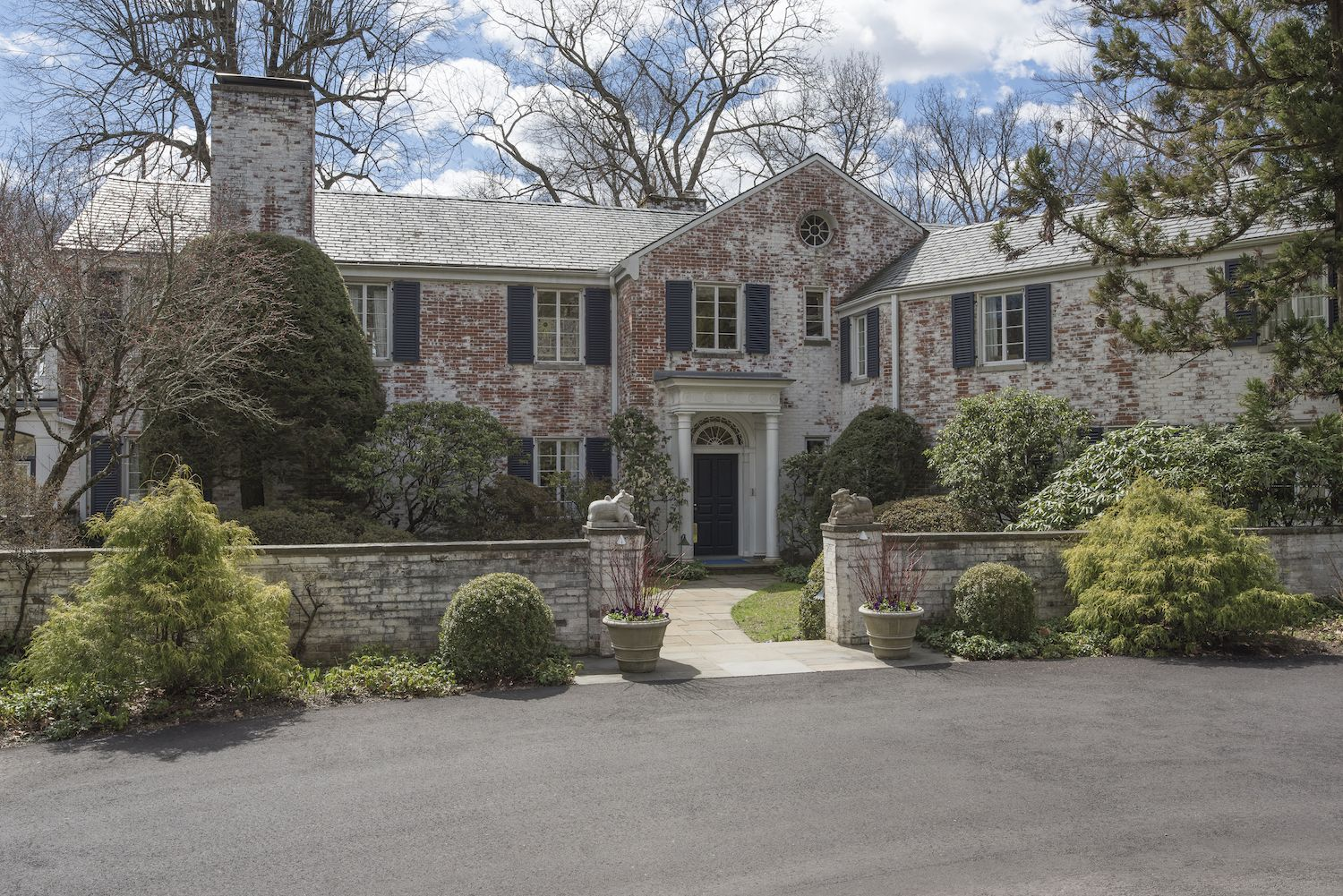 Though extremely secluded, the Georgian-style home is located close to New Canaan center.