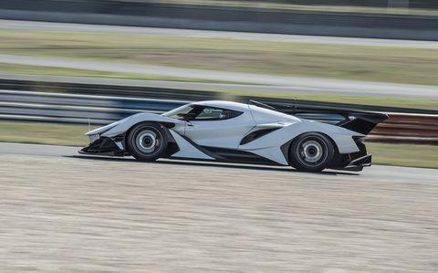 Supercar, Vehicle, Automotive design, Sports car, Car, Race track, Endurance racing (motorsport), Performance car, Coupé, Racing,