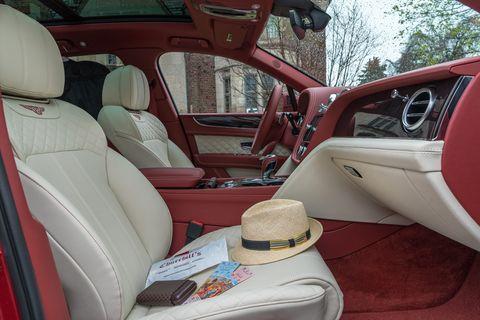 Land vehicle, Vehicle, Car, Motor vehicle, Car seat cover, Luxury vehicle, Car seat, Sedan, Center console,