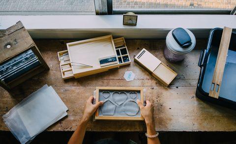 Table, Design, Furniture, Automotive design, Room, Wallet, Technology, Wood, House, Interior design,