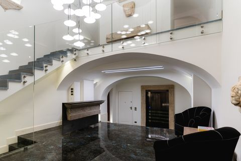 Property, Room, Interior design, Building, Lobby, Arch, Living room, Ceiling, Stairs, Architecture,