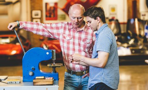 James and Jesse Glickenhaus at shop with VIN stamping press
