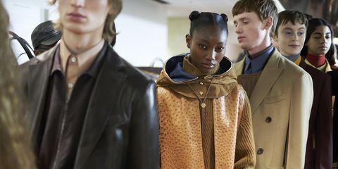 Outerwear, Fashion, Event, Jacket, Fashion design, Uniform, Suit, Coat, Overcoat,