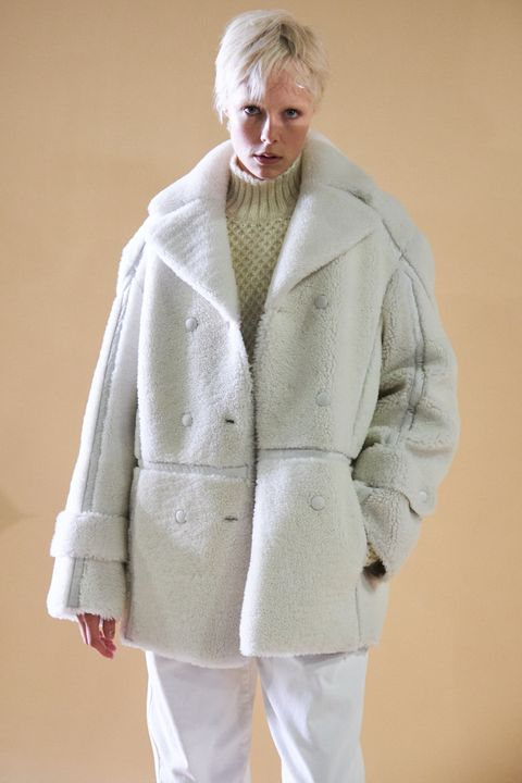 Clothing, White, Overcoat, Outerwear, Coat, Skin, Fashion, Fur, Beige, Sleeve,