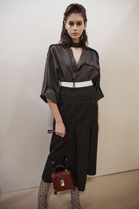 Fashion model, Clothing, Fashion, Shoulder, Fashion show, Fashion design, Photo shoot, Neck, Dress, Model,