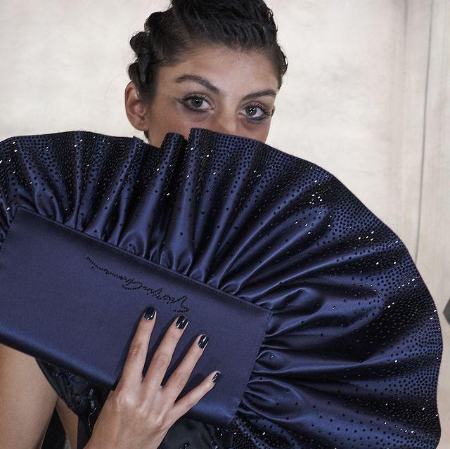 Beauty, Fashion, Hand fan, Shoulder, Outerwear, Black hair, Fashion design, Neck, Model, Sleeve,