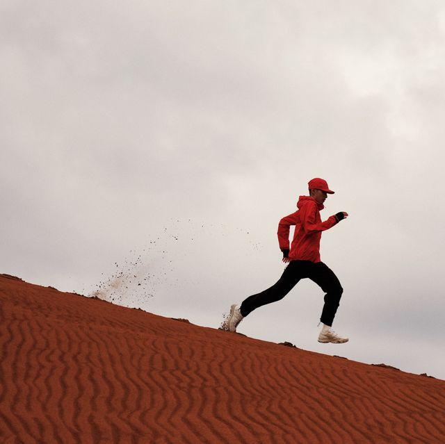 man running wearing goldwin shell