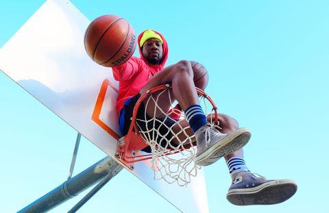 jonathan majors on a basketball hoop