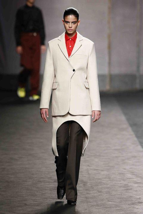 Fashion, Fashion model, Clothing, Runway, Fashion show, Suit, Formal wear, Outerwear, Human, Fashion design,