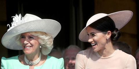 Meghan Markle with Prince Charles and Camilla Parker Bowles