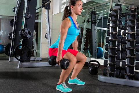 dumbbell squat woman workout at gym
