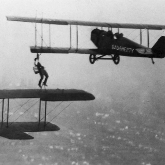 vintage photos   man refueling a plane in mid air