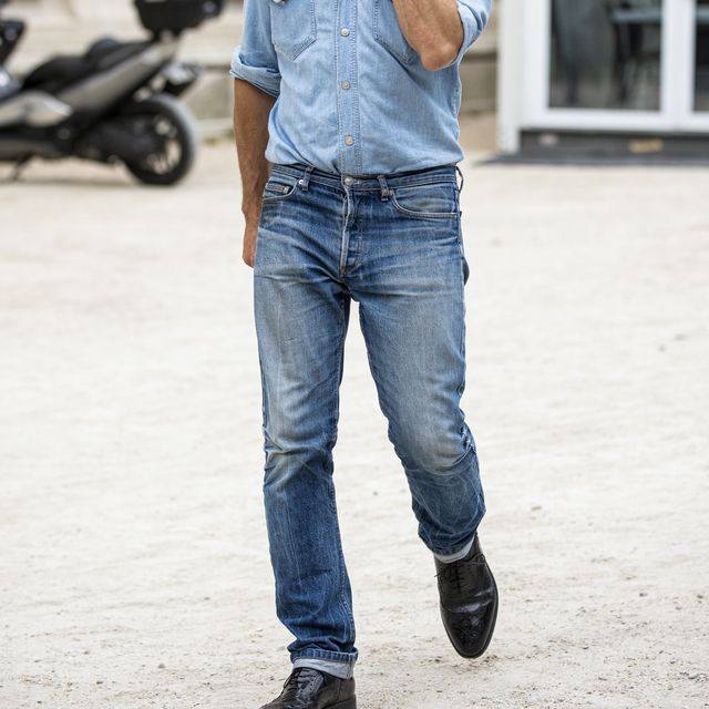 paris, france   june 19 a guest, wearing a light blue denim shirt, blue jeans and black shoes, is seen outside valentino fashion show on day 2 during the paris fashion week springsummer 2020 on june 19, 2019 in paris, france photo by claudio laveniagetty images
