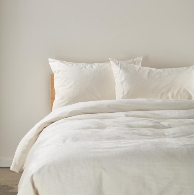 cream bedding on bed