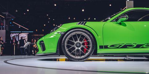 Land vehicle, Vehicle, Car, Automotive design, Rim, Supercar, Auto show, Sports car, Alloy wheel, Wheel,