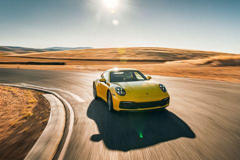 Land vehicle, Vehicle, Automotive design, Car, Performance car, Yellow, Sports car, Rolling, Supercar, Landscape,