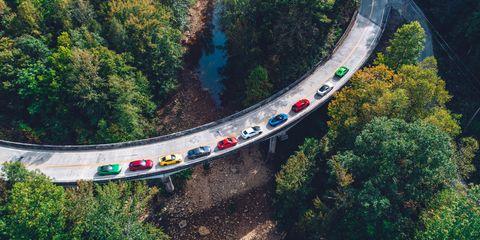 Transport, Bridge, Road, Infrastructure, Thoroughfare, Tree, Mountain pass, Aerial photography, Geological phenomenon, Landscape,