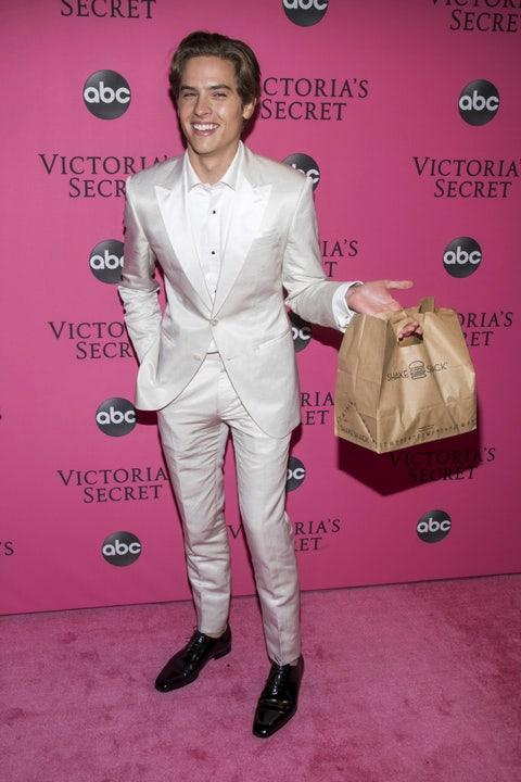 Pink, Suit, Red carpet, Premiere, Carpet, Outerwear, Formal wear, Pantsuit, Flooring, Tuxedo,