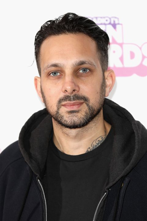 Dynamo stands on the red carpet posing for a photograph