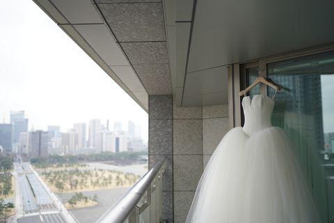 Architecture, Wedding dress, Tower block, Metropolitan area, Bridal clothing, Condominium, Gown, Apartment, Daylighting, Transparent material,