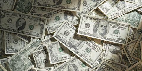 Piles of Money Cash Dollar Bills