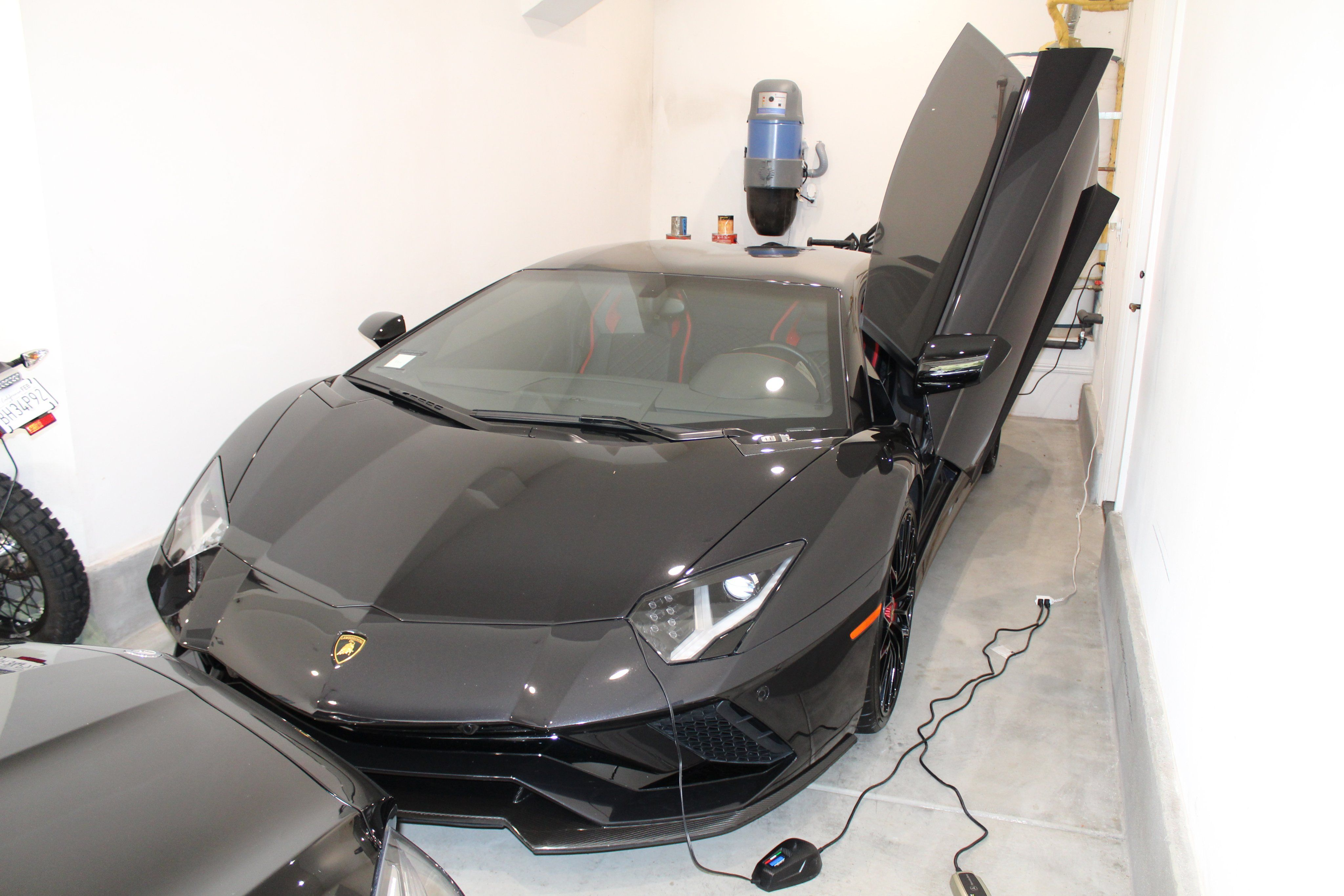Man Allegedly Uses Pandemic Relief Funds to Buy a Lamborghini, Ferrari, and Bentley