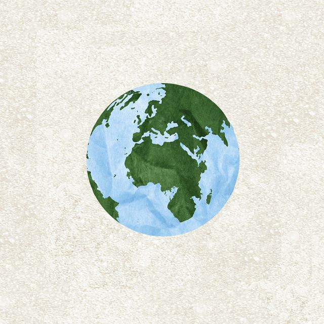 earth hand cut out of paper