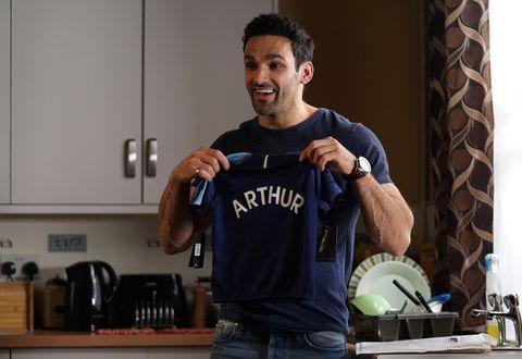 Kush Kazemi has bought a football shirt for Arthur in EastEnders