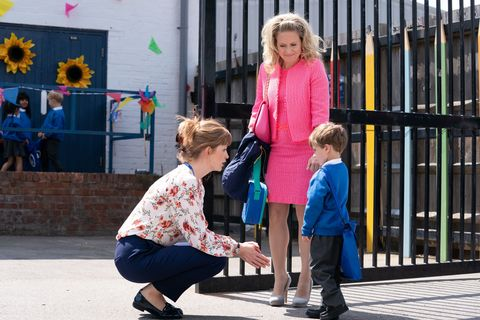 Linda Carter with Ollie and his new teacher in EastEnders