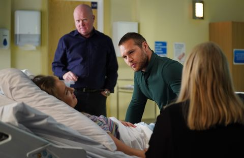 Louise Mitchell at the hospital with her family in EastEnders