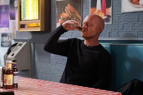 Max Branning drinks at the cafe in EastEnders