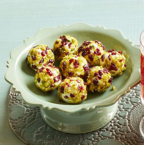 festive goat cheese balls on green cake stand