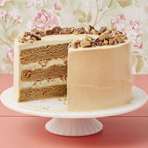coffee toffee crunch cake on white cake stand