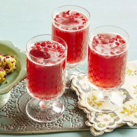pomegranate sparklers three glasses with napkin and appetizer plate