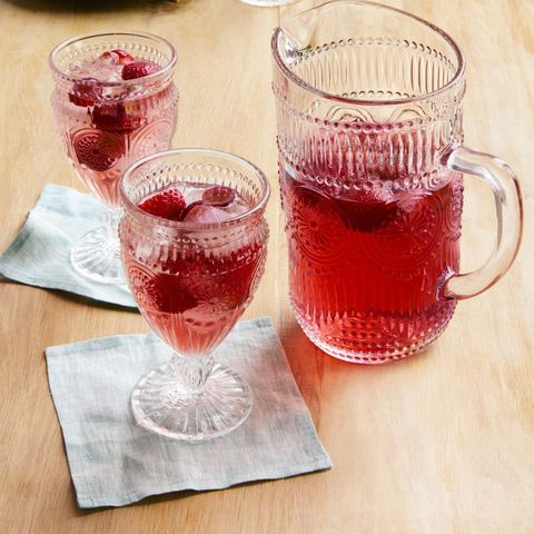 strawberry sangria in pitcher and two glasses