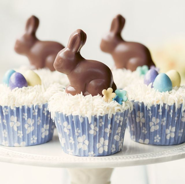 cupcakes topped with chocolate easter bunnies and eggs