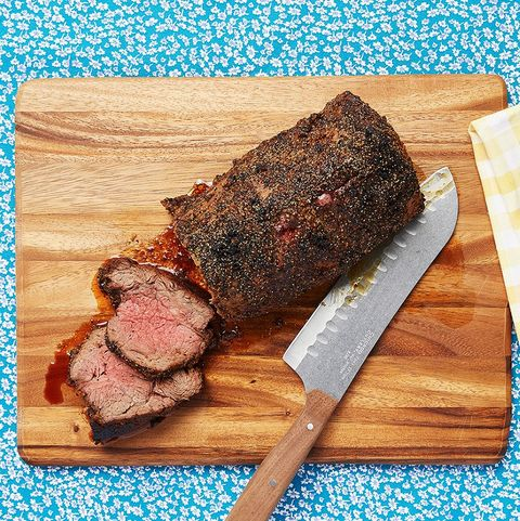roasted beef tenderloin on carving block with knife