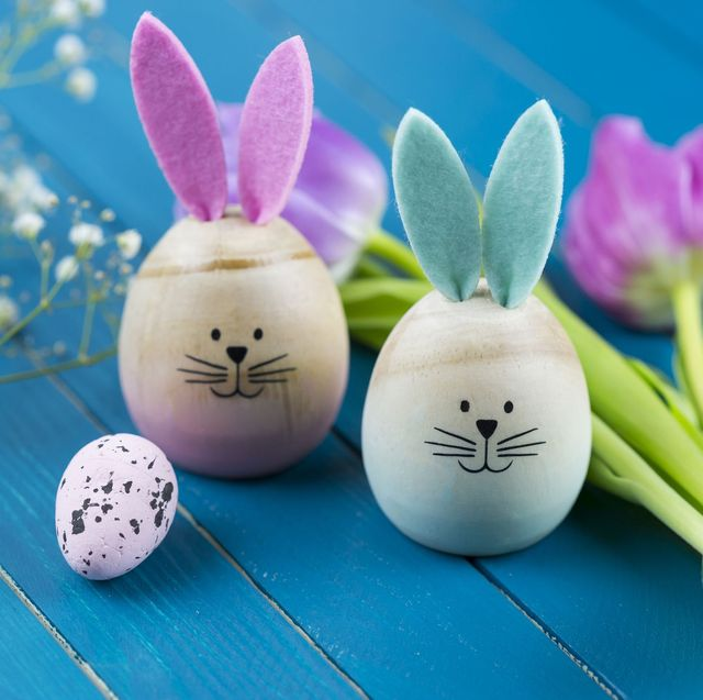 wooden easter eggs dressed up like bunnies