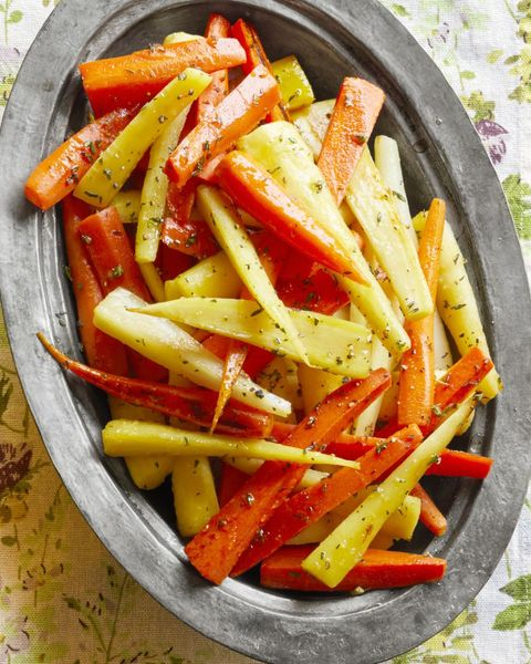 honey glazed carrots and parsnips on metal tray