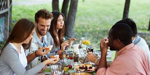 group of friends eating meal outside