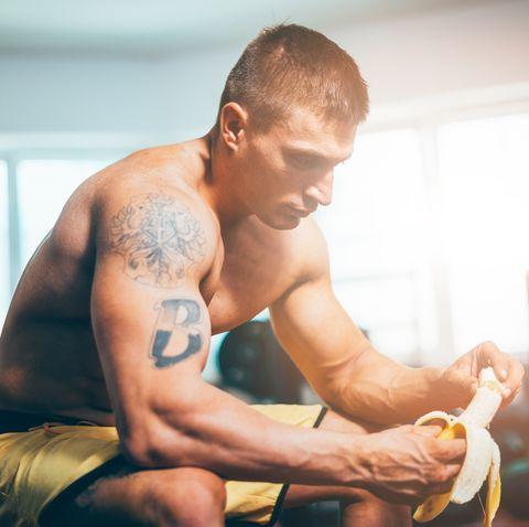 Eating banana during training in gym